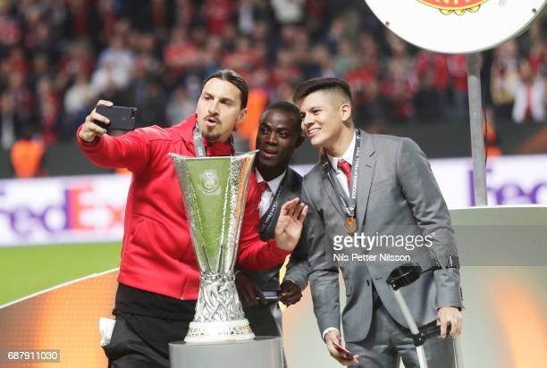 Zlatan Ibrahimovi of Manchester United takes a selfie with the trophy during the UEFA Europa League Final between Ajax and Manchester United at...