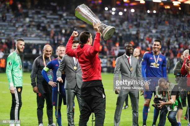 Zlatan Ibrahimovi of Manchester United with the trophy during the UEFA Europa League Final between Ajax and Manchester United at Friends Arena on May...