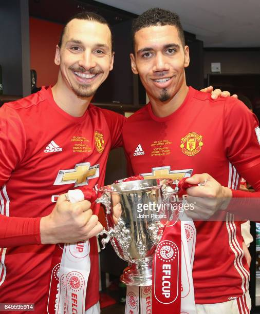 Zlatan Ibrahimovic and Chris Smalling of Manchester United celebrate in the dressing room after the EFL Cup Final match between Manchester United and...