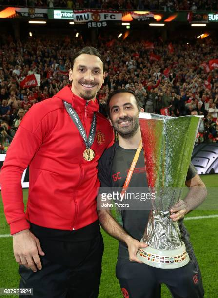 Zlatan Ibrahimovic and Coach Giovanni Cerra of Manchester United celebrate with the Europa League trophy after the UEFA Europa League Final match...