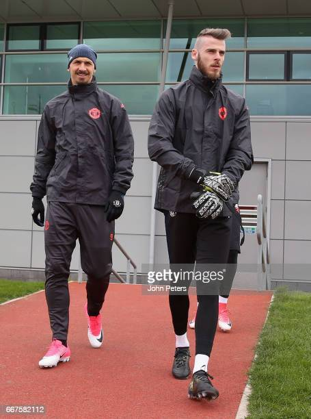 Zlatan Ibrahimovic and David de Gea of Manchester United walk out ahead of a first team training session at Aon Training Complex on April 12 2017 in...