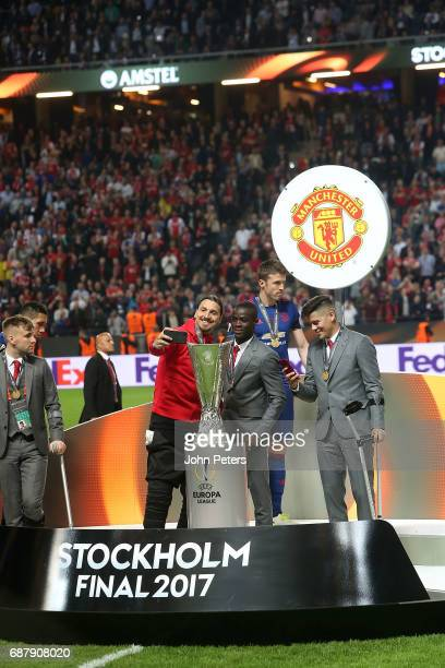 Zlatan Ibrahimovic and Eric Bailly of Manchester United celebrate after the UEFA Europa League Final match between Manchester United and Ajax at...