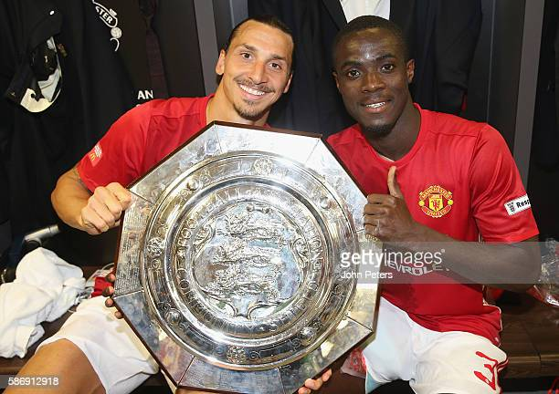 Zlatan Ibrahimovic and Eric Bailly of Manchester United pose with the Community Shield trophy in the dressing room after the FA Community Shield...