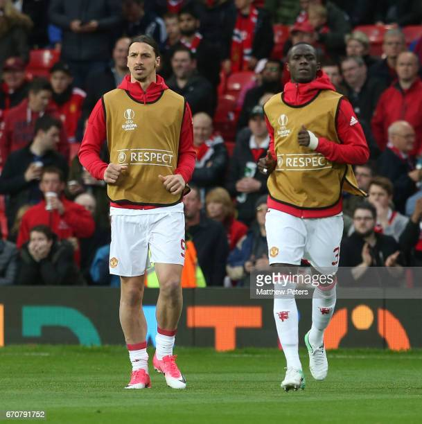 Zlatan Ibrahimovic and Eric Bailly of Manchester United warm up ahead of the UEFA Europa League quarter final second leg match between Manchester...