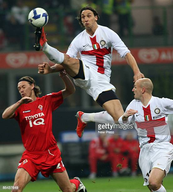 Zlatan Ibrahimovic and Esteban Cambiasso of Inter in action with and Per Kroldrup of Fiorentina during the Serie A match between Inter and Fiorentina...