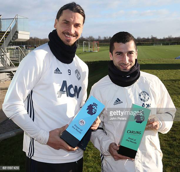 Zlatan Ibrahimovic and Henrikh Mkhitaryan of Manchester United pose with their Carling Player of the Month and Carling Goal of the Month for December...