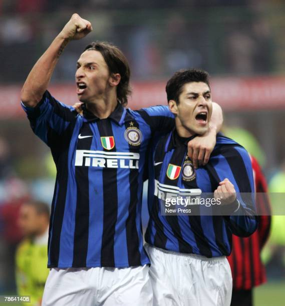 Zlatan Ibrahimovic and Julio Cruz of Inter Milan celebrate after Cruz had scored a goal during the Serie A match between Inter Milan and AC Milan at...