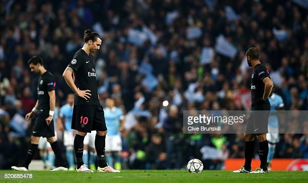Zlatan Ibrahimovic and Lucas Moura of Paris SaintGermain look dejected as Kevin de Bruyne of Manchester City scores their first goal during the UEFA...