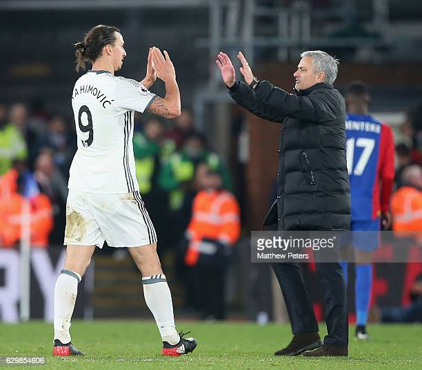 Zlatan Ibrahimovic and Manager Jose Mourinho of Manchester United celebrate after the Premier League match between Crystal Palace and Manchester...