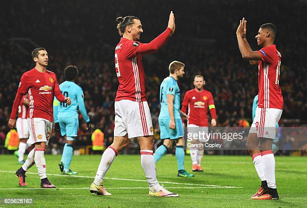 Zlatan Ibrahimovic and Marcus Rashford of Manchester United celebrate as Brad Jones of Feyenoord scores an own goal for their third during the UEFA...