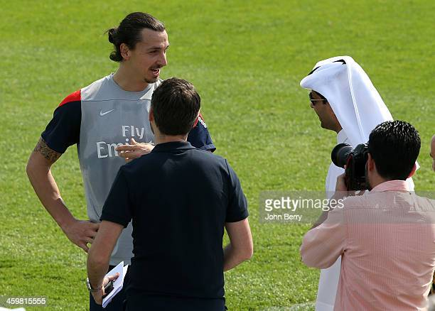 Zlatan Ibrahimovic and Nasser AlKhelaifi president of PSG chat on the practice field during day 3 of the Paris SaintGermain Training Camp the Qatar...
