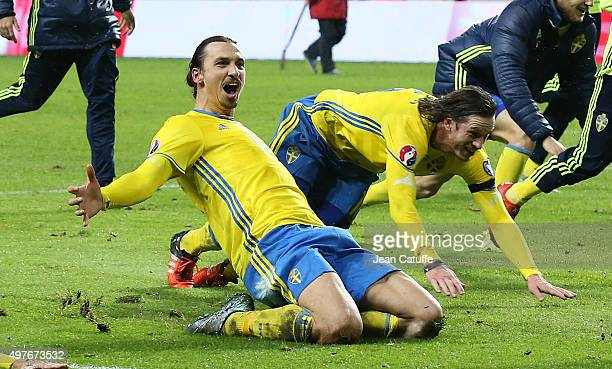 Zlatan Ibrahimovic and Pontus Wernbloom of Sweden celebrate the qualification for the EURO 2016 in France following the UEFA EURO 2016 qualifier...