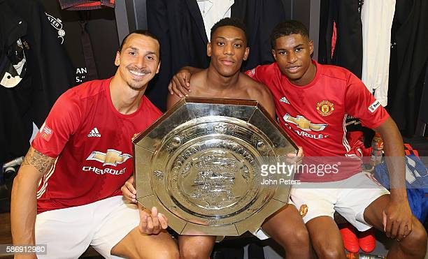 Zlatan Ibrahimovic Anthony Martial and Marcus Rashford of Manchester United pose with the Community Shield trophy in the dressing room after the FA...