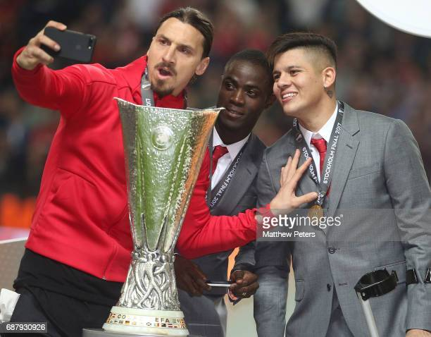Zlatan Ibrahimovic Eric Bailly and Marcos Rojo of Manchester United celebrate with the Europa League trophy after the UEFA Europa League Final match...