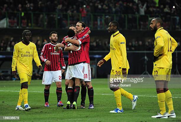 Zlatan Ibrahimovic of AC Milan celebrates scoring his penalty with team mates during the UEFA Champions League round of 16 first leg match between AC...