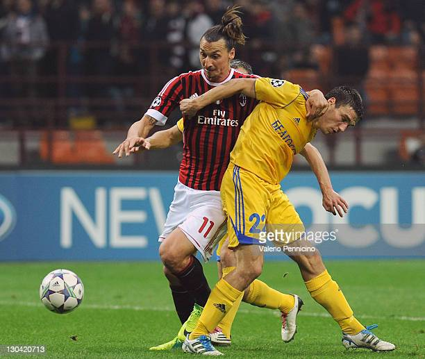 Zlatan Ibrahimovic of AC Milan competes with Marko Simic of FC BATE Borisov during the UEFA Champions League group H match between AC Milan and FC...