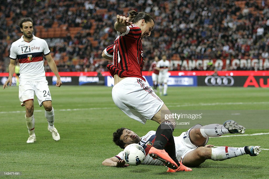<a gi-track='captionPersonalityLinkClicked' href=/galleries/search?phrase=Zlatan+Ibrahimovic&family=editorial&specificpeople=206139 ng-click='$event.stopPropagation()'>Zlatan Ibrahimovic</a> of AC Milan is tackled by <a gi-track='captionPersonalityLinkClicked' href=/galleries/search?phrase=Kakha+Kaladze&family=editorial&specificpeople=646904 ng-click='$event.stopPropagation()'>Kakha Kaladze</a> of Genoa CFC during the Serie A match between AC Milan and Genoa CFC at Stadio Giuseppe Meazza on April 25, 2012 in Milan, Italy.
