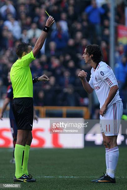 Zlatan Ibrahimovic of AC Milan receives the yellow card from referee Paolo Silvio Mazzoleni during the Serie A match between Genoa CFC and AC Milan...