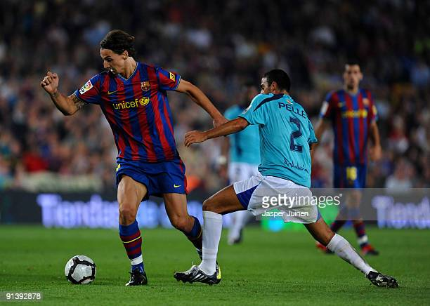 Zlatan Ibrahimovic of Barcelona duels for the ball with Hernan Dario during the La Liga match between Barcelona and Almeria at the Camp Nou Stadium...