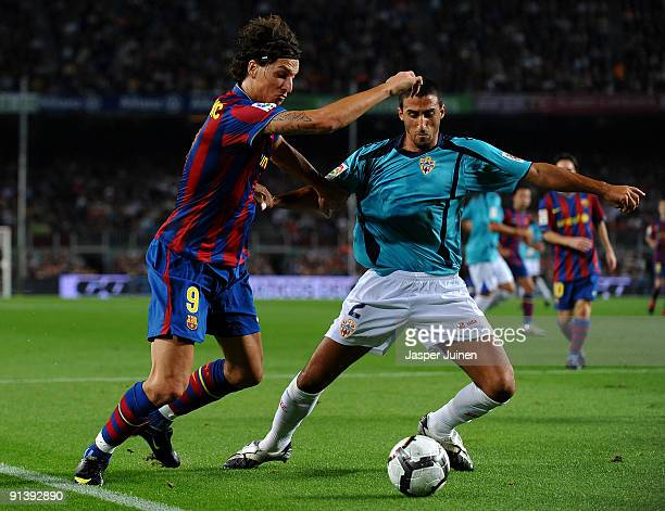 Zlatan Ibrahimovic of Barcelona duels for the ball with Hernan Dario of Almeria during the La Liga match between Barcelona and Almeria at the Camp...