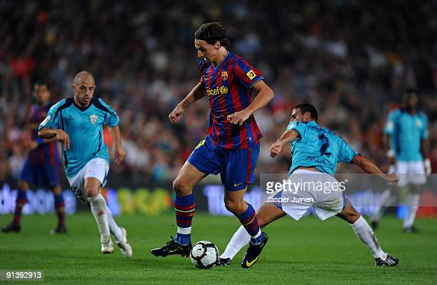 Zlatan Ibrahimovic of Barcelona duels for the ball with Hernan Dario and Hernan Bernardello of Almeria during the La Liga match between Barcelona and...