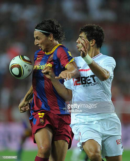 Zlatan Ibrahimovic of Barcelona is challenged by Federico Fazio of Sevilla during the Supercopa first leg match between Sevilla and Barcelona at the...