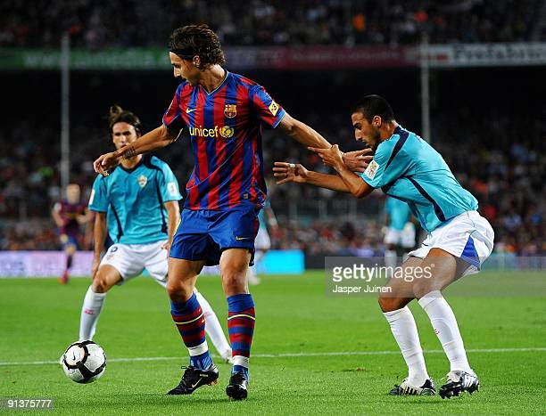 Zlatan Ibrahimovic of Barcelona shields the ball from Hernan Dario of Almeria during the La Liga match between Barcelona and Almeria at the Camp Nou...