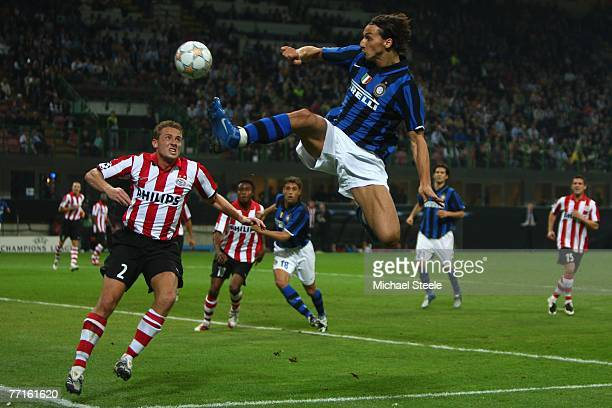 Zlatan Ibrahimovic of Inter leaps towards the ball ahead of Jan Kromkamp of PSV during the UEFA Champions League Group G match between Inter Milan...