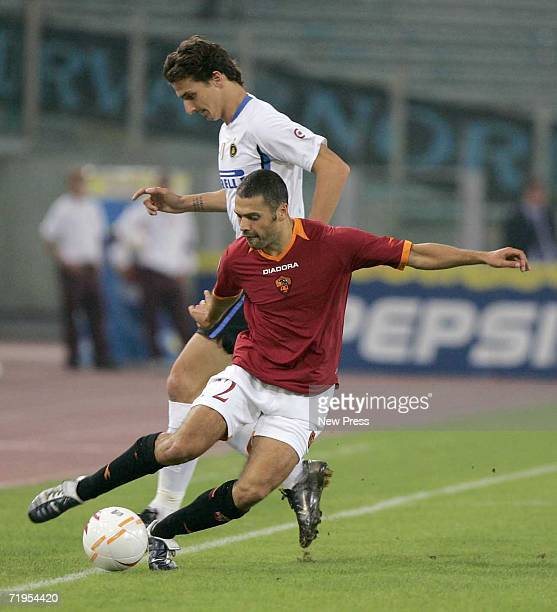 Zlatan Ibrahimovic of Inter Milan controls the ball defended by Max Tonetto of Roma during action at the Olympic Stadium September 20 2006 in Rome...