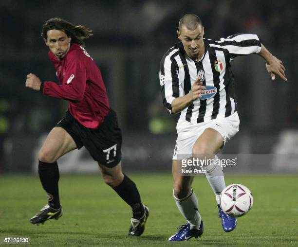 Zlatan Ibrahimovic of Juventus evades Alessandro Grandoni of Livorno during the Serie A match between Livorno and Juventus at the Stadio Armando...