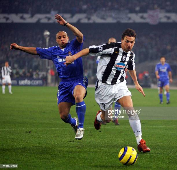 Zlatan Ibrahimovic of Juventus holds off Roberto Carlos of Real Madrid during the UEFA Champions League 1st knockout round second leg between...