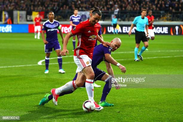 Zlatan Ibrahimovic of Manchester United and Bram Nuytinck of RSC Anderlecht in action during the UEFA Europa League quarter final first leg match...