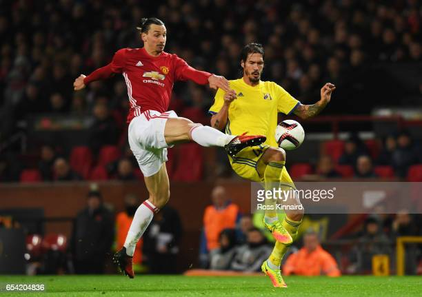 Zlatan Ibrahimovic of Manchester United and Cesar Navas of FC Rostov battle for the ball during the UEFA Europa League Round of 16 second leg match...