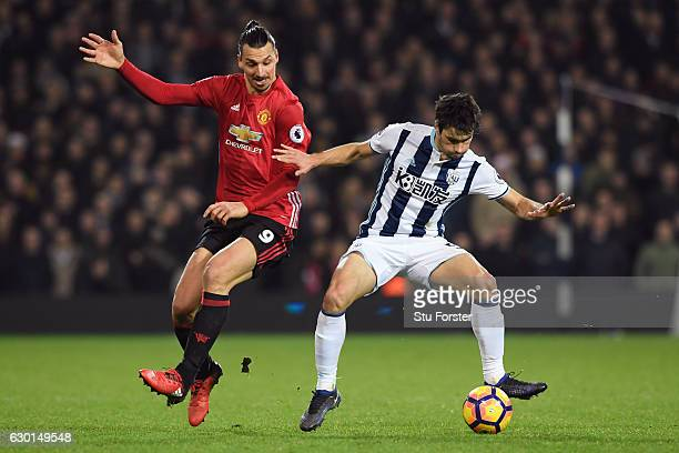 Zlatan Ibrahimovic of Manchester United and Claudio Yacob of West Bromwich Albion battle for possession during the Premier League match between West...