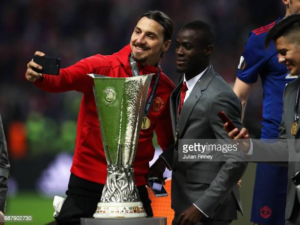 Zlatan Ibrahimovic of Manchester United and Eric Bailly of Manchester United take a selfie photograph with the trophy after the UEFA Europa League...