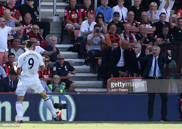 Zlatan Ibrahimovic of Manchester United and Manager Jose Mourinho celebrate after the third goal made the score 03 during the Premier League match...