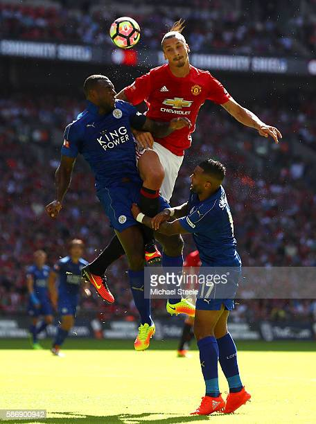 Zlatan Ibrahimovic of Manchester United battle for possesion in the air with Wes Morgan of Leicester City and Danny Simpson of Leicester City during...