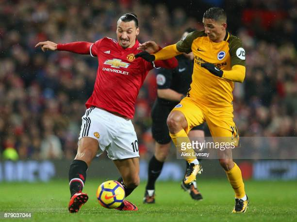 Zlatan Ibrahimovic of Manchester United battles for possesion with Anthony Knockaert of Brighton and Hove Albion during the Premier League match...