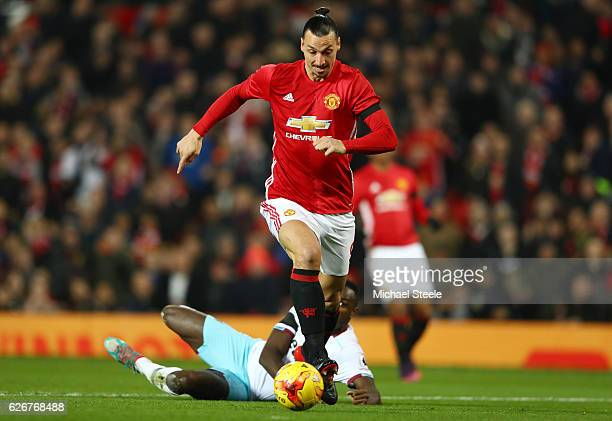 Zlatan Ibrahimovic of Manchester United breaks away from Michail Antonio of West Ham United on his way to scoring the opening goal of the game during...