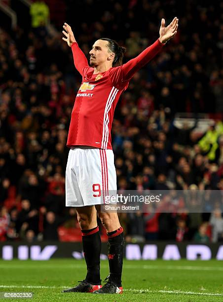 Zlatan Ibrahimovic of Manchester United celebrates after scoring his team's fourth goal of the game during the EFL Cup quarter final match between...