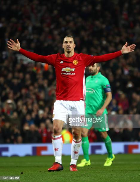 Zlatan Ibrahimovic of Manchester United celebrates after scoring his third and his sides third goal during the UEFA Europa League Round of 32 first...