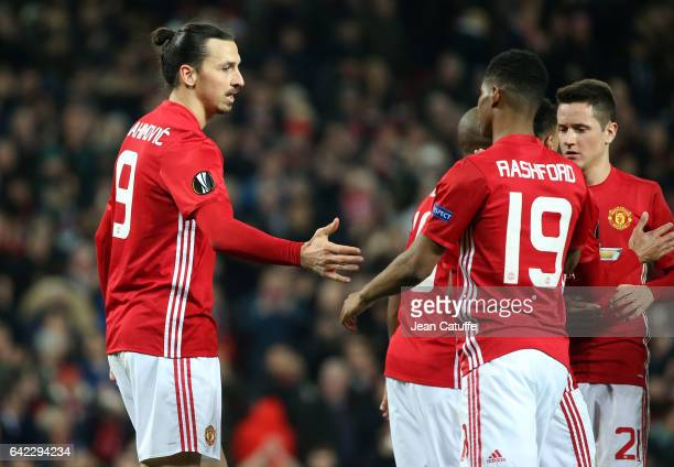 Zlatan Ibrahimovic of Manchester United celebrates his third goal with Marcus Rashford of Manchester United during the UEFA Europa League Round of 32...