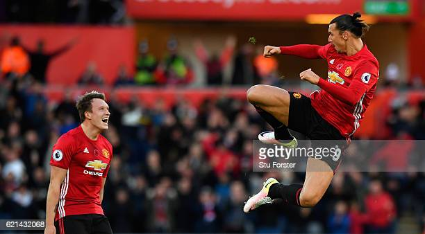 Zlatan Ibrahimovic of Manchester United celebrates scoring his sides second goal with Phil Jones during the Premier League match between Swansea City...
