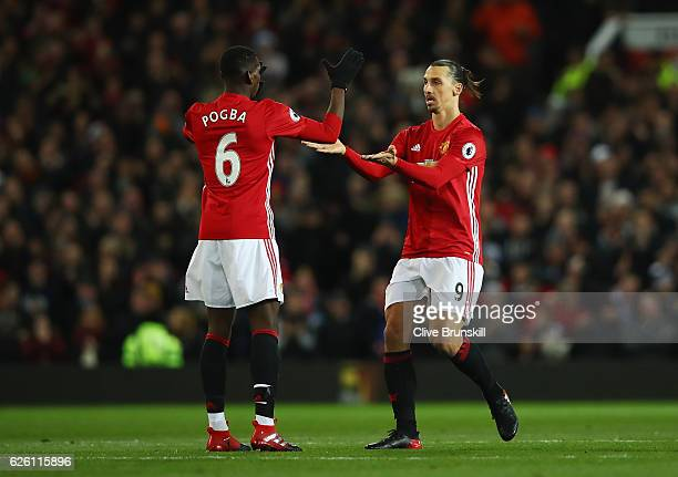 Zlatan Ibrahimovic of Manchester United celebrates scoring his sides first goal with Paul Pogba of Manchester United during the Premier League match...