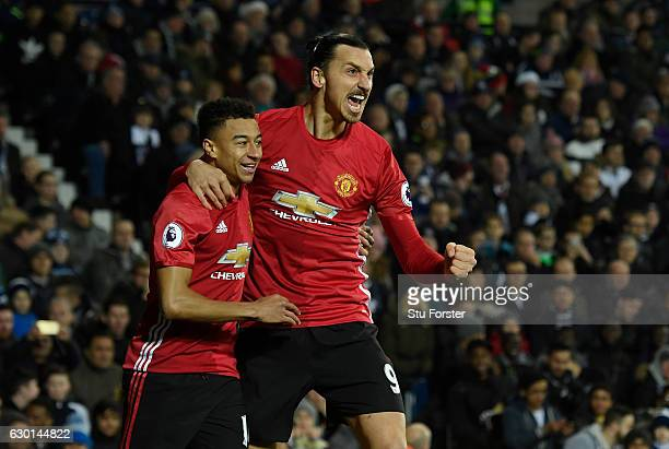 Zlatan Ibrahimovic of Manchester United celebrates scoring his sides first goal with Jesse Lingard of Manchester United during the Premier League...