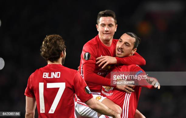 Zlatan Ibrahimovic of Manchester United celebrates scoring his sides first goal with Ander Herrera during the UEFA Europa League Round of 32 first...