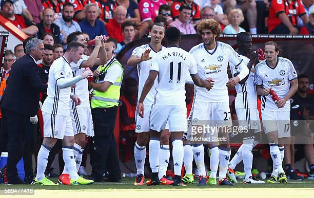 Zlatan Ibrahimovic of Manchester United celebrates scoring his team's third goal with team mates and manager Jose Mourinho during the Premier League...