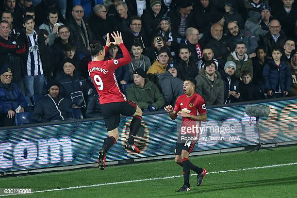Zlatan Ibrahimovic of Manchester United celebrates scoring the first goal with Jesse Lingard to make the score 01 during the Premier League match...