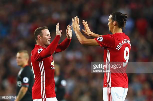 Zlatan Ibrahimovic of Manchester United celebrates scoring the opening goal with Wayne Rooney of Manchester United during the Premier League match...