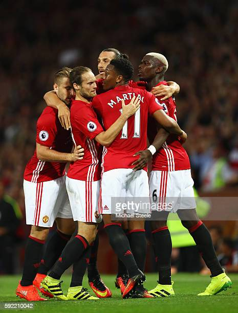 Zlatan Ibrahimovic of Manchester United celebrates scoring the opening goal with Paul Pogba and team mates during the Premier League match between...